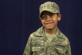 Kid Smiling in Uniform
